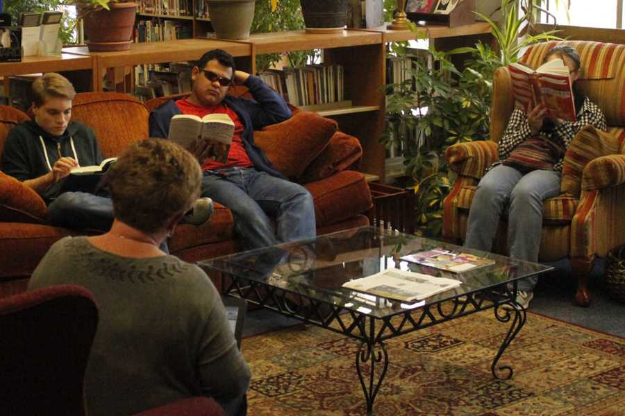 Sponsor Anita Glover quizzes senior Sam Reece (l-r), junior Harry Perez, and freshman Bella Fancher during Battle of the Books practice.
