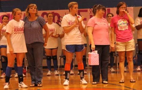 Team recognizes breast cancer survivors
