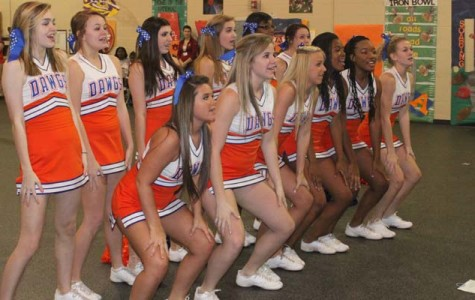 Cheerleaders energize students in Iron Bowl pep rally