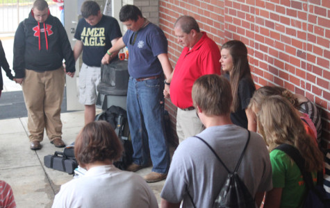 Students and faculty offer prayers at See You at the Pole event