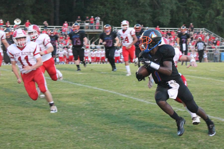 Junior Daqwan Bryant runs the ball against the Tiger defense.  Bryant later had in a interception for the Bulldogs.