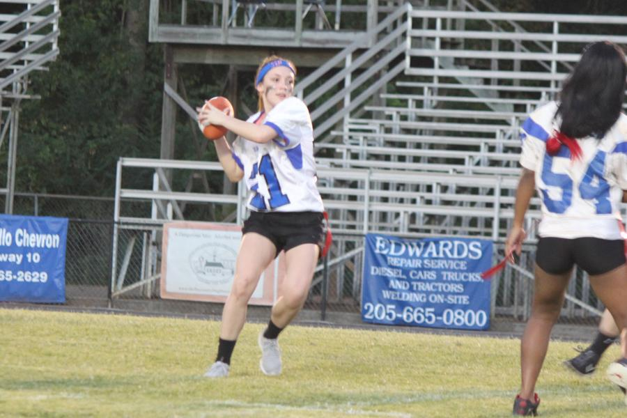 Senior Lacey Hamrick draws back for a pass during the powderpuff championship game.  The seniors lost to the juniors 0-6.