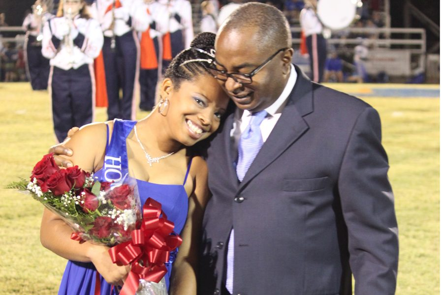 Senior Joi Hodge hugs her father after being announced and crowned as the 2016 Homecoming Queen.