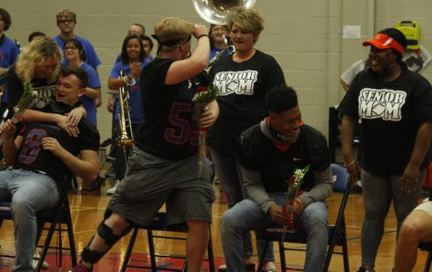 Seniors (l-r) Jackson Hughes, Matthew Allen and Tre'Shawn Brown are shocked to see that it was a kiss from their moms that they received while they were blindfolded at the senior peprally.