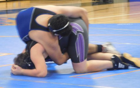 Freshman Ariel Suarez pins his opponent in the match against Prattville, Feb. 2.
