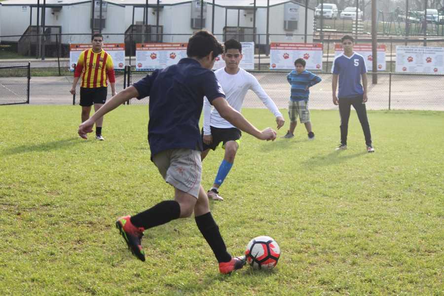 Sophomore Uriel Alvarado faces off against defensive player Heriberto Casildo during soccer practice.