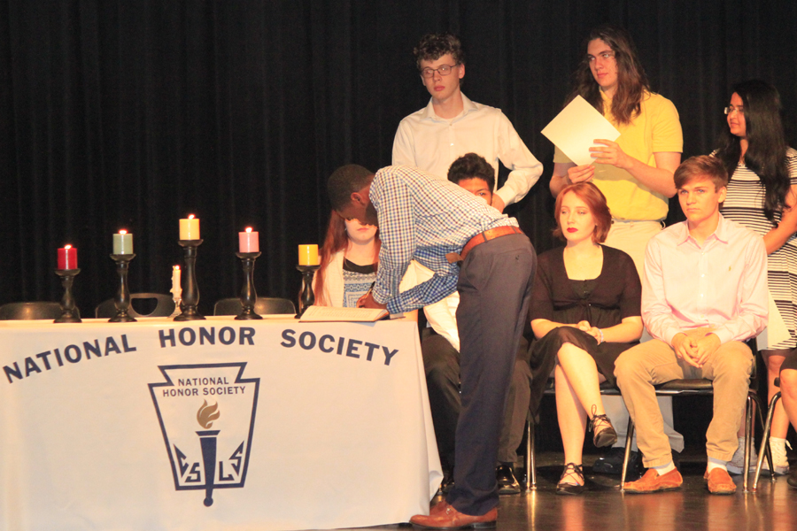 Junior+Daqwan+Bryant+signs+a+pledge+as+part+of+the+induction+into+the+National+Honor+Society.