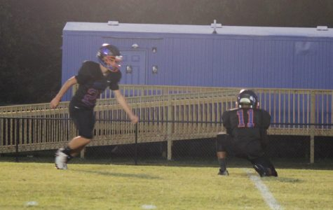 Senior Dalston Grisham kicks an extra point in the game against BB Comer.  The Bulldogs claimed the Homecoming victory with the score, 35-12.