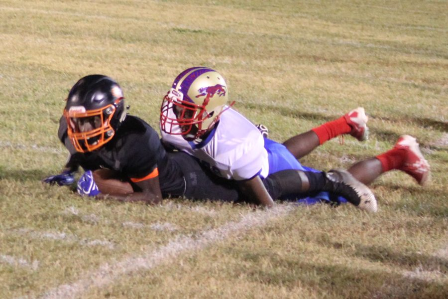 Sophomore Deon Gilliland gains yardage before getting stopped by the Tigers.