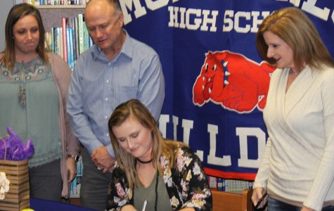 Hughes signs softball scholarship with UM