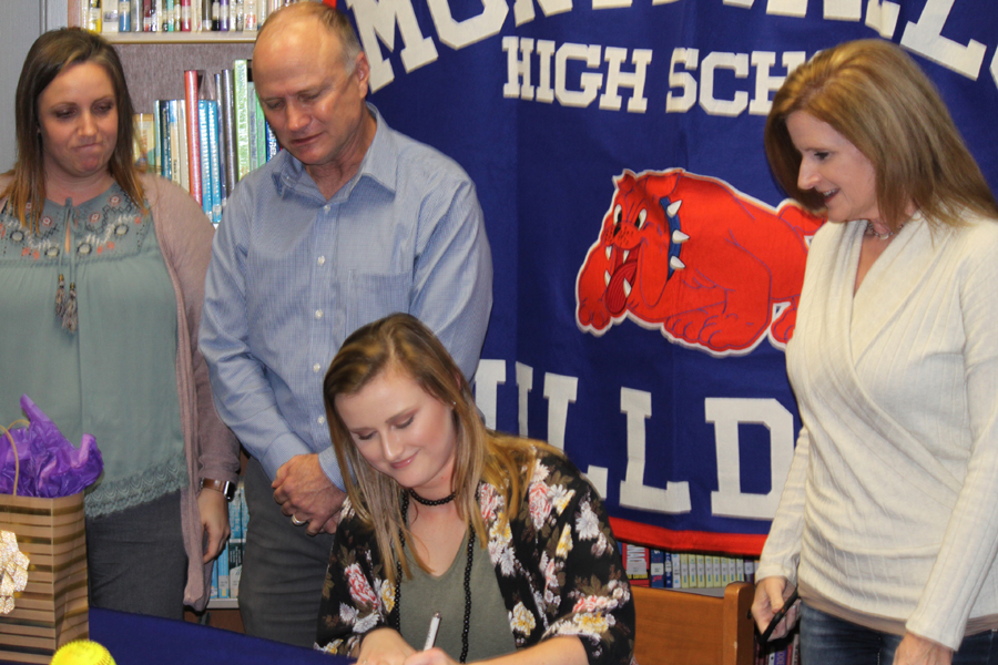 Senior Georgia Hughes signs a softball scholarship with the University of Montevallo.