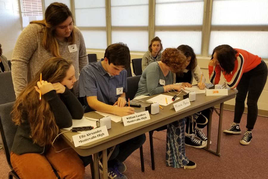 The Junior Varsity Scholars' Bowl team works on question worksheet during the Scholars' Bowl Competition, Thursday, Feb. 8.