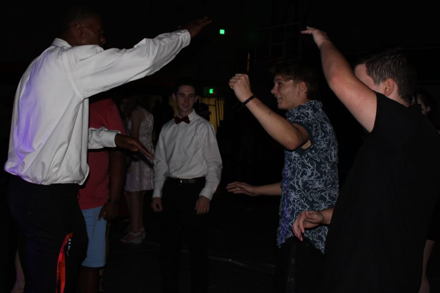 Junior JaBrian Sullens (l) teaches junior Wilson Massey (l-r) and senior Gabe Dutton his dance moves.