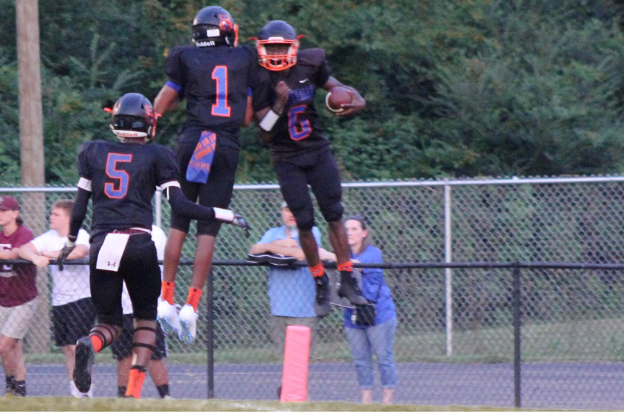 Junior JJ Evans and Junior Deon Gilliland celebrate Gilliland's first touchdown of the year.