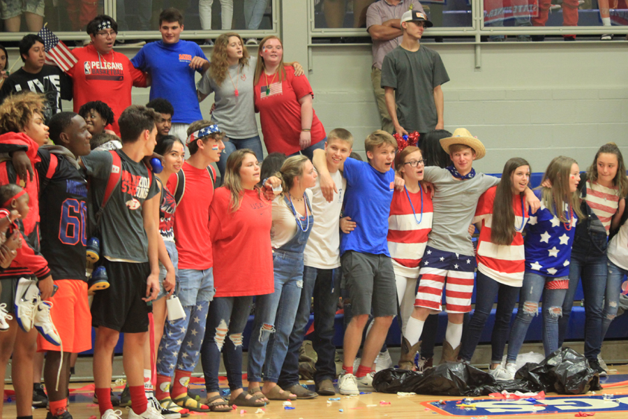 The junior class sings the Alma Mater after being announced as the winner of the spirit stick.